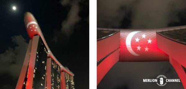 シンガポールの国旗カラーにライトアップされたマリーナベイサンズ